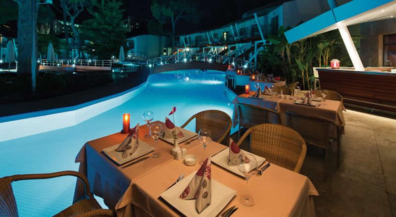 tables set by the pool side