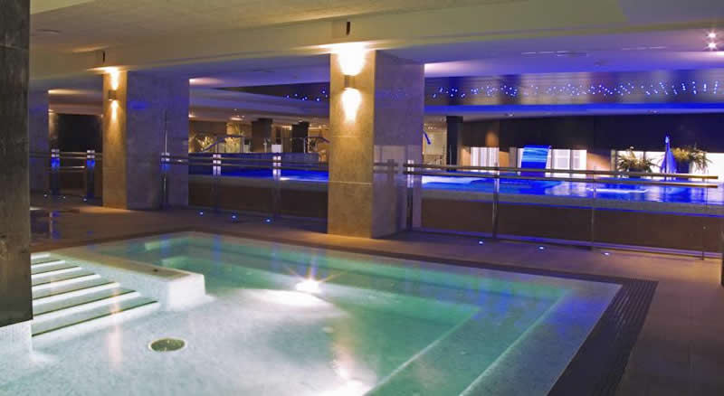 the indoor swimming pool at the envia almeria golf and wellness hotel