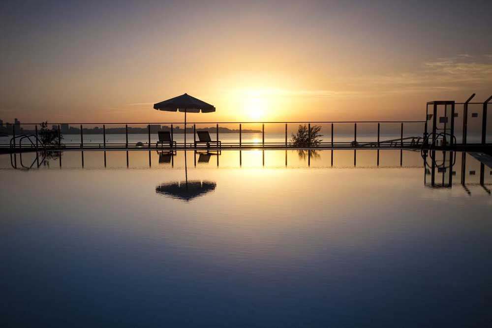 sunset over the pool of Melia Alicante Hotel