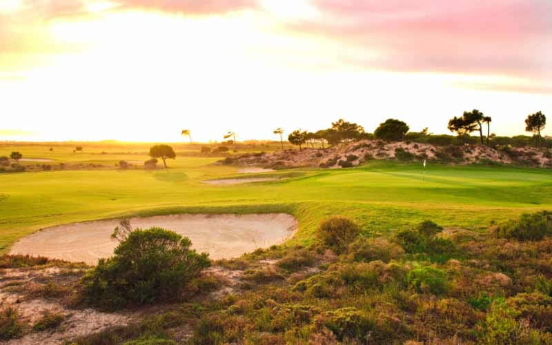 a massive bunke guards the 15th green at Oitavos Dunes