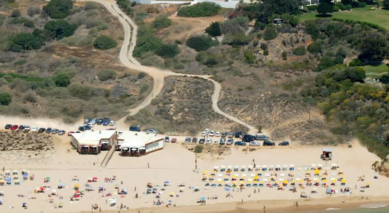 ariel view of the beach in front of the delfim hotel