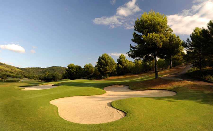 bunkers surround the 15th green at son vida golf course, mallorca