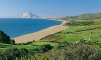 Alcaidesa Links golf course with gibraltar in the distance