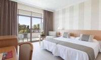 a refurbished double bedroom with sea views at Atalaya Park hotel