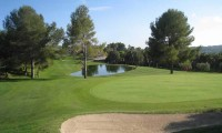a lake beside the 17th green at Costa Dorada Golf Club