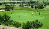 golfers on the 18th green of la envia golf course