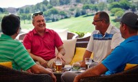 golfers relaxing on the terrance bar of the La Cala clubhouse