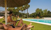 relaxing by the pool at the NH Sotogrande Hotel