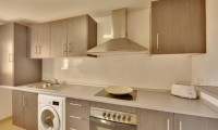 a kitchen at the residences mar menor golf resort