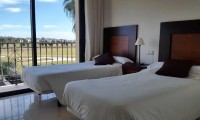 a twin bedroom with views of the Roda golf course